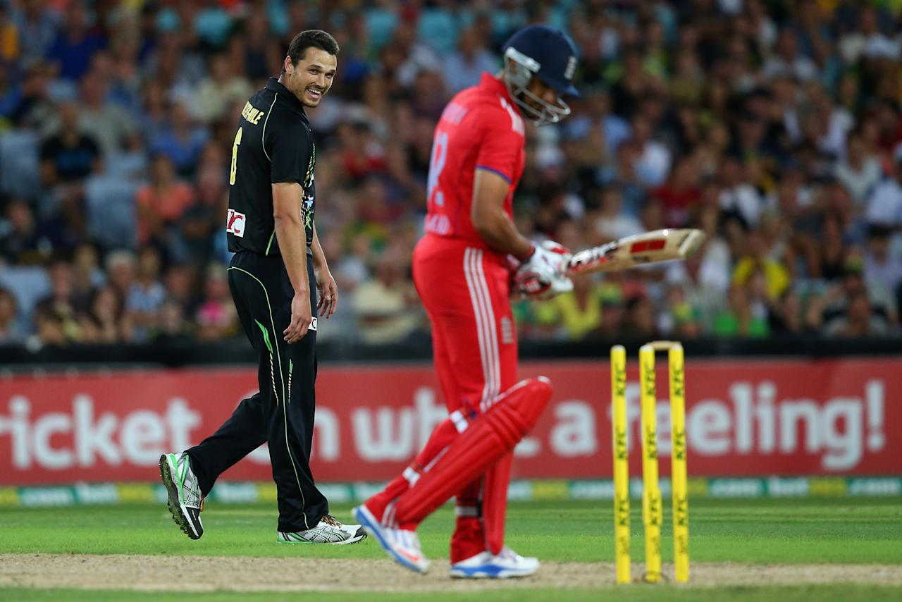 SYDNEY, AUSTRALIA - FEBRUARY 02:  Nathan Coulter-Nile of Australia laughs after taking the wicket of Ravi Bopara of England during game three of the International Twenty20 series between Australia and England at ANZ Stadium on February 2, 2014 in Sydney, Australia.  (Photo by Mark Kolbe/Getty Images)
