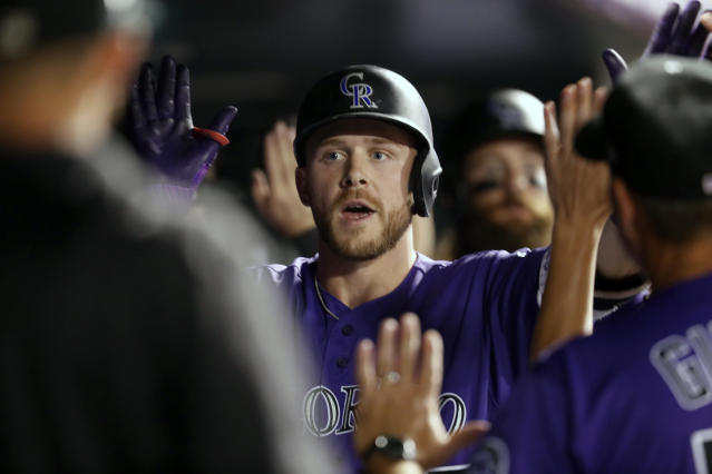 Teammates congratulate Colorado Rockies' Trevor Story as he returns to the dugout after hitting three-run home run off Arizona Diamondbacks relief pitcher Silvino Bracho in the fifth inning of a baseball game Monday, Sept. 10, 2018, in Denver. (AP Photo/David Zalubowski)