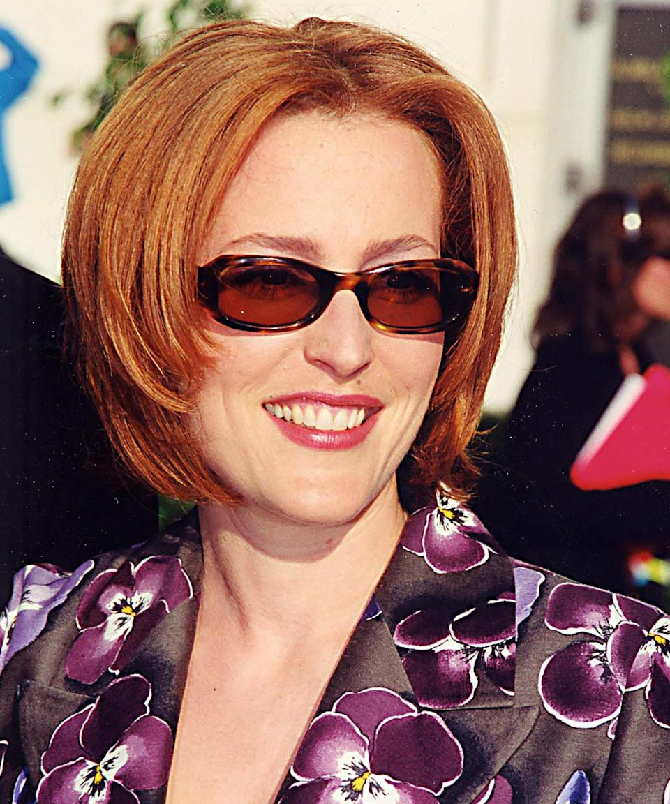 """<strong><h2>Gillian Anderson</h2></strong><br>When Anderson reprised her iconic role as supernatural investigator Dana Scully from the '90s hit <em><a href=""""https://www.refinery29.com/en-us/2017/04/151234/the-x-files-coming-back-fox"""" rel=""""nofollow noopener"""" target=""""_blank"""" data-ylk=""""slk:X-Files"""" class=""""link rapid-noclick-resp"""">X-Files</a> </em>a few years ago, fans were disappointed that she chose to wear a wig instead of going back to her famous copper hair. Turns out, Anderson was just as excited to be a redhead again — but was warned by a colorist that she risked <a href=""""https://ew.com/article/2015/06/26/x-files-gillian-anderson-why-im-wearing-wig-play-scully/"""" rel=""""nofollow noopener"""" target=""""_blank"""" data-ylk=""""slk:going bald"""" class=""""link rapid-noclick-resp"""">going bald</a> to play Scully <em>without</em> a wig. At least we still have retro Scully for some inspo.<span class=""""copyright"""">Photo: Jeff Kravitz/FilmMagic, Inc.</span>"""