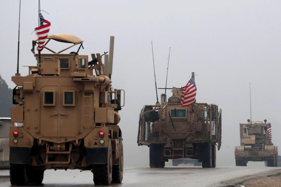 Image: U.S. military vehicles in Syria (Delil Souleiman / AFP - Getty Images file)