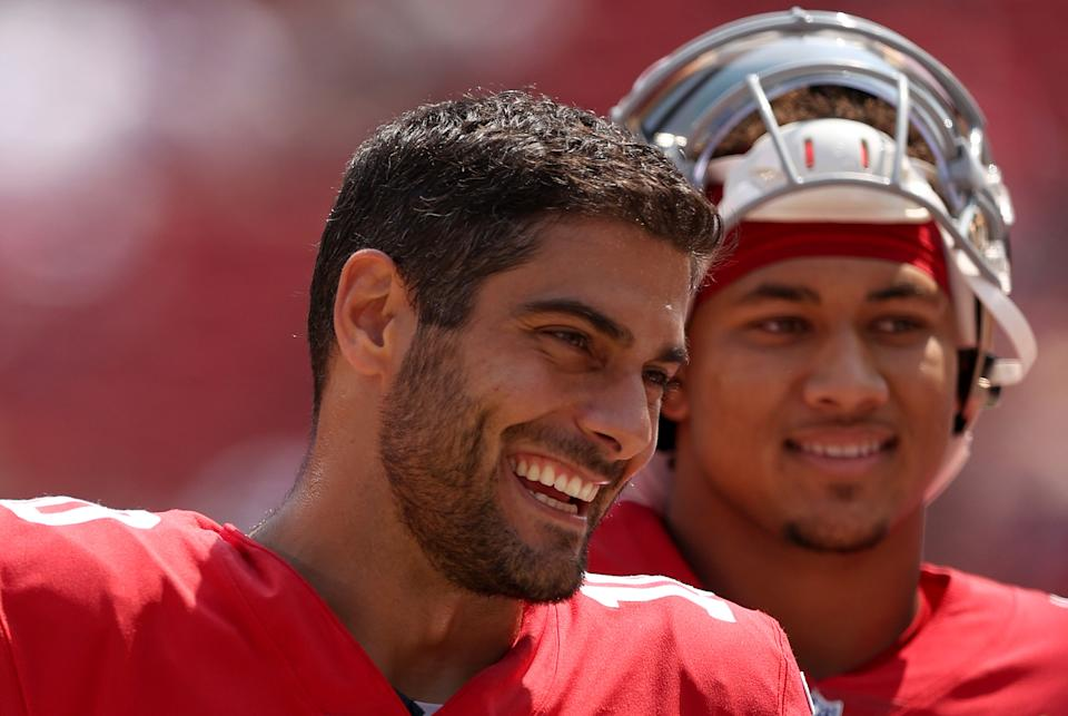 SANTA CLARA, CALIFORNIA - AUGUST 29: Jimmy Garoppolo #10 and Trey Lance #5 of the San Francisco 49ers talk to each other on the sidelines before their preseason game against the Las Vegas Raiders at Levi's Stadium on August 29, 2021 in Santa Clara, California. (Photo by Ezra Shaw/Getty Images)