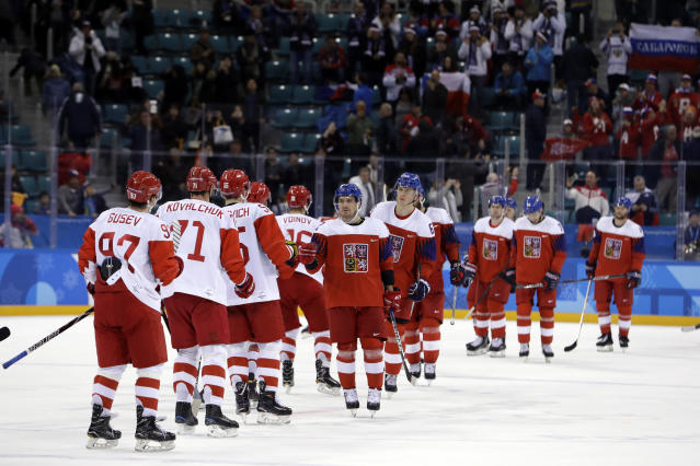 Olympic Athletes from Russia and the Czech Republic greet each other after the semifinal round of the men's hockey game at the 2018 Winter Olympics in Gangneung, South Korea, Friday, Feb. 23, 2018. Olympic Athletes from Russia won 3-0. (AP Photo/Matt Slocum)