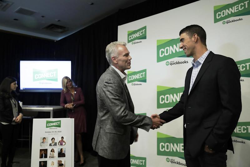 CORRECTS ID TO INTUIT CHAIRMAN AND CEO BRAD SMITH INSTEAD OF QUICKBOOKS CONNECT CHAIRMAN AND CEO BRAND SMITH - In this Tuesday, Oct. 25, 2016, photo, former Olympic swimmer Michael Phelps, right, shakes hands with Intuit Chairman and CEO Brad Smith in San Jose, Calif. Phelps is looking for his next golden opportunity in business after retiring from his sport as the most decorated athlete in Olympic history. He thinks he might find it in Silicon Valley, joining a growing list of athletes and entertainers trying to build upon their fortunes in a technology-driven area teeming with geeky millionaires. (AP Photo/Marcio Jose Sanchez)