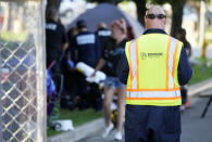 A city-sponsored sweep is carried out on an encampment of individuals living along Grant Street at Sixth Avenue south of downtown Denver, Wednesday, July 7, 2021. (AP Photo/David Zalubowski)
