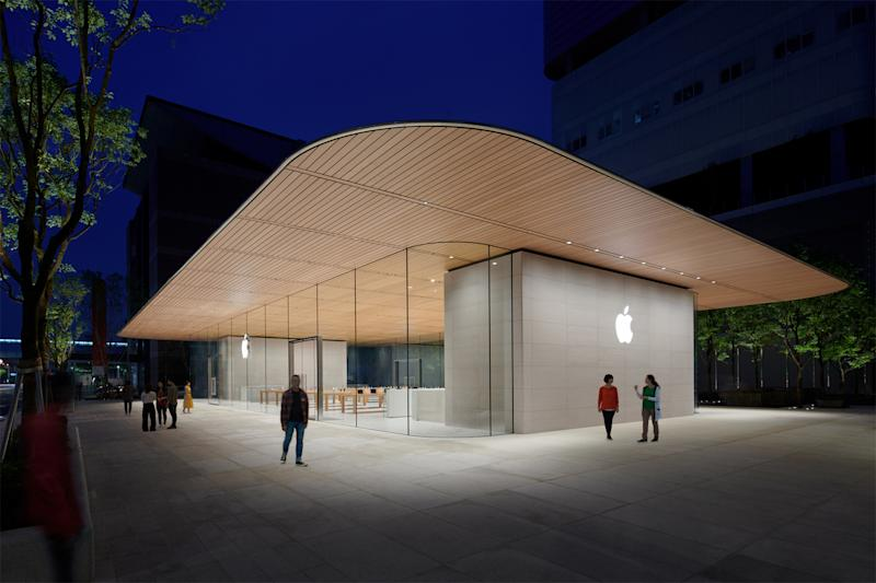 94284c348d53c The new Apple store in Taipei with a wooden roof overextending the glass  exterior and the