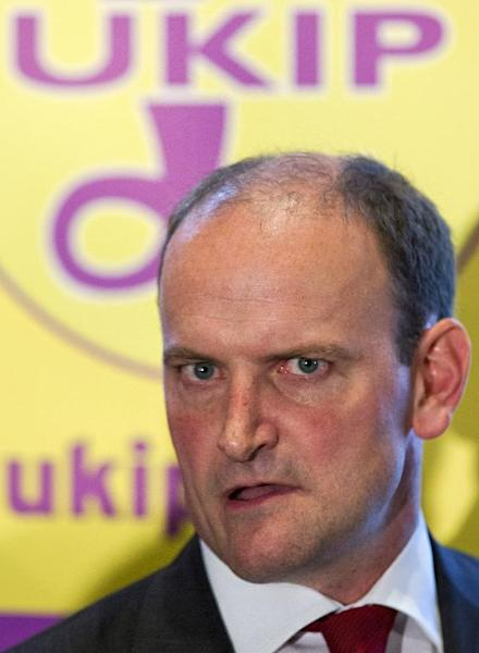 Defecting Conservative MP Douglas Carswell speaks to journalists in central London on August 28, 2014 as he announces he is joining UKIP (AFP Photo/Justin Tallis)