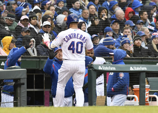 Chicago Cubs' Willson Contreras (40) is greeted after scoring against the Milwaukee Brewers during the first inning of a baseball game, Sunday, May, 12, 2019, in Chicago. (AP Photo/David Banks)