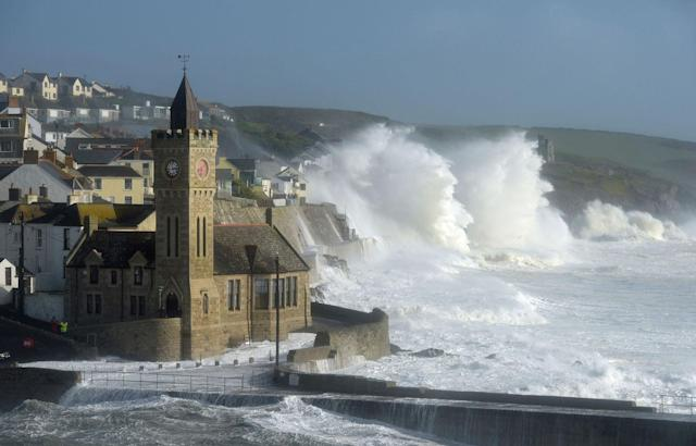 <p>Waves break around the church in the harbour at Porthleven, Cornwall southwestern England, as the remnants of Hurricane Ophelia begins to hit parts of Britain and Ireland on Oct. 16, 2017. Ireland's meteorological service is predicting wind gusts of 120 kph to 150 kph (75 mph to 93 mph), sparking fears of travel chaos. (Photo: Ben Birchall/PA via AP) </p>