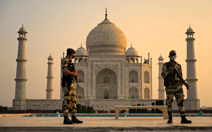 Soldier patrol the ground at the Taj Mahal after it reopened to visitors following authorities easing Covid-19 coronavirus restrictions in Agra on June 16, 2021 - AFP