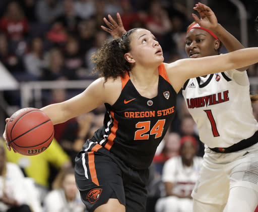 Louisville guard Dana Evans (1) defends against Oregon State guard Destiny Slocum (24) during the first half of a regional semifinal game in the NCAA women's college basketball tournament, Friday, March 29, 2019, in Albany, N.Y. (AP Photo/Kathy Willens)
