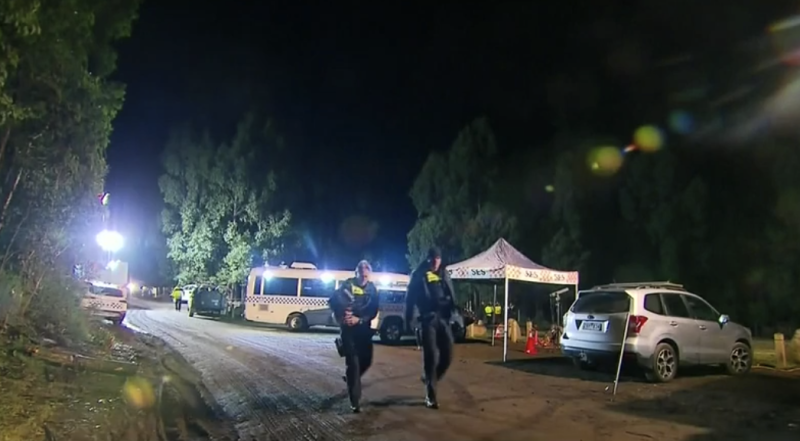 Police and SES continued to search for William Callaghan overnight. Pictured is the search party at the scene in Victoria.