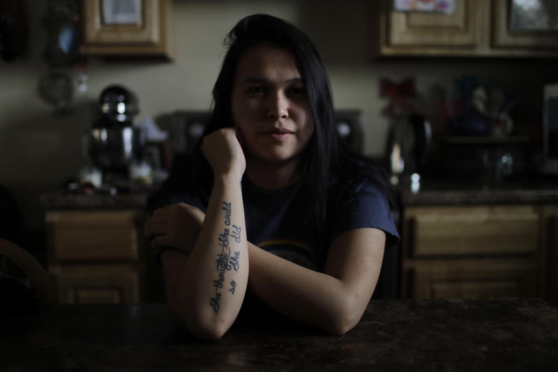 In this Feb. 16, 2019, photo, Deidre Levi sits at the table of her grandmother's home in the Native Village of St. Michael, Alaska. Levi says she spoke up about being sexually assaulted because she wanted to be a role model for girls in Alaska. (AP Photo/Wong Maye-E)