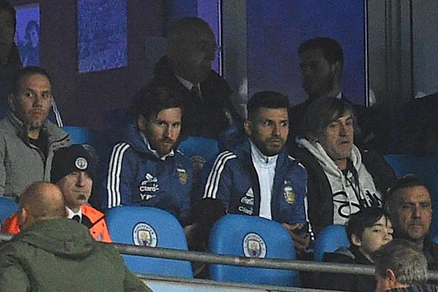 Sidelined: Lionel Messi sits alongside Sergio Aguero after being named on the bench for the friendly between Argentina and Italy in Manchester (AFP Photo/Oli SCARFF)