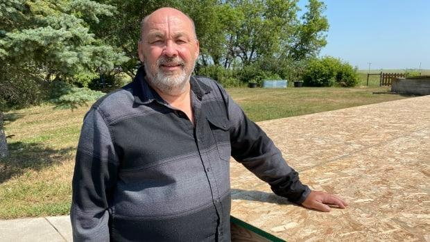 George Parker at the construction site of his new music studio at his home in Cando, Saskatchewan.  (Don Somers/CBC - image credit)