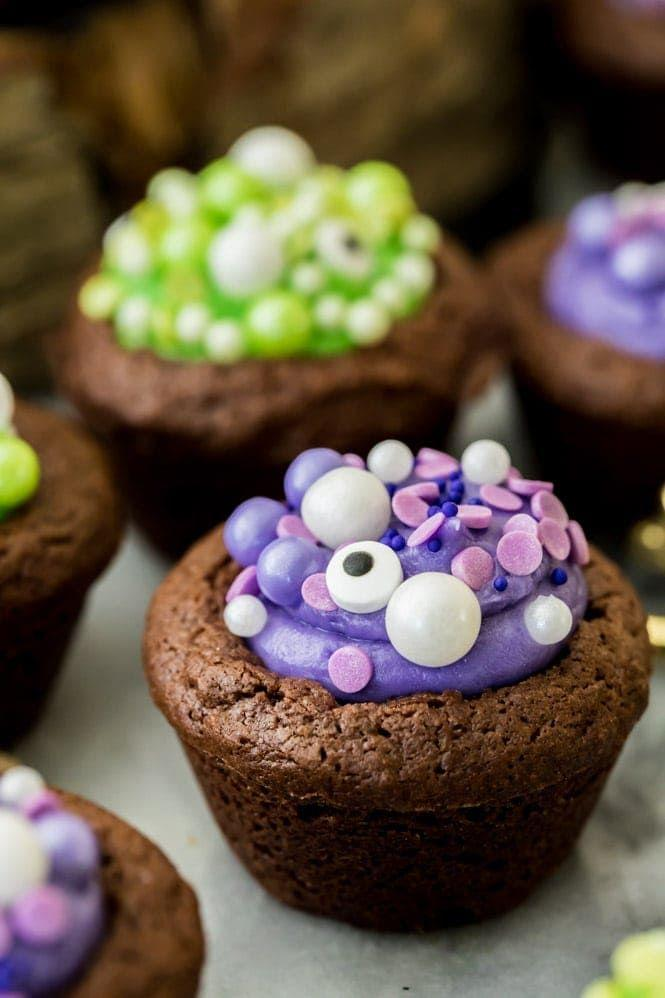 """<p>Brownie batter cupcakes filled with colorful cream cheese frosting make a fun and festive dessert.</p><p><em><a href=""""https://sugarspunrun.com/witch-cauldron-brownie-bites-halloween-dessert/"""" rel=""""nofollow noopener"""" target=""""_blank"""" data-ylk=""""slk:Get the recipe from Sugar Spun Run »"""" class=""""link rapid-noclick-resp"""">Get the recipe from Sugar Spun Run »</a></em></p>"""