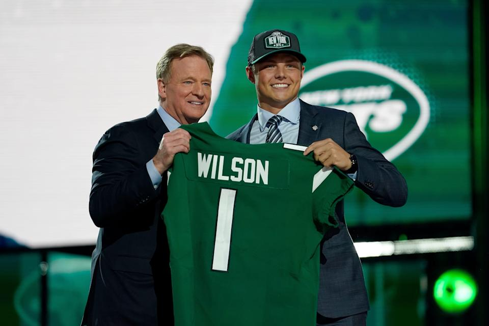 BYU quarterback Zach Wilson, right, poses for a photo with NFL Commissioner Roger Goodell after being drafted by the New York Jets in the first round of the NFL football draft, Thursday, April 29, 2021, in Cleveland.