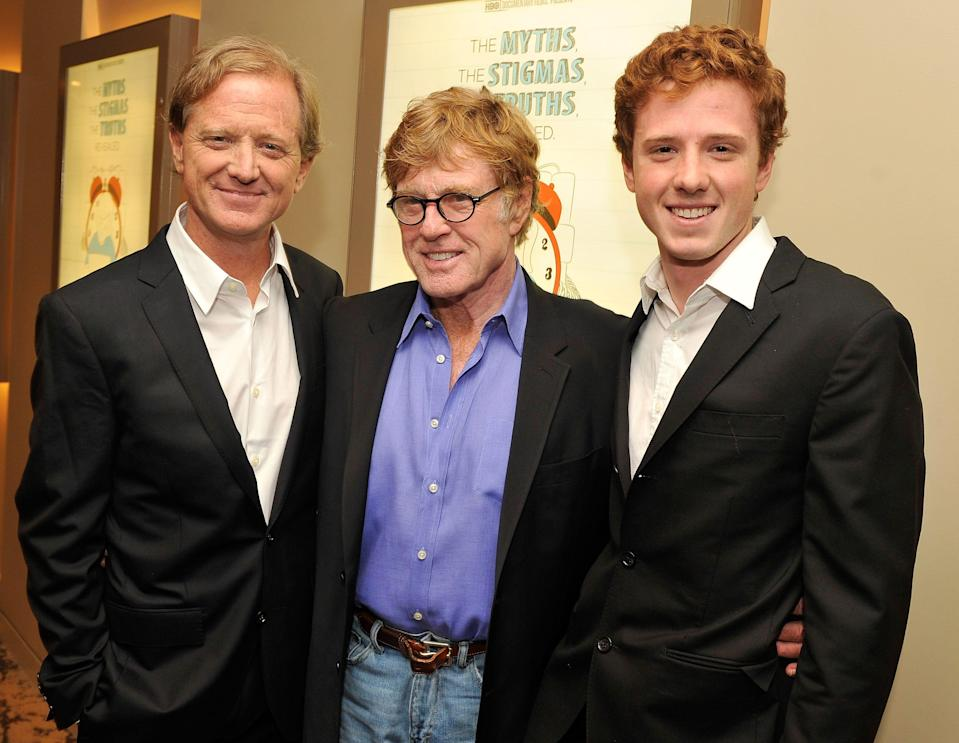 "Film legend Robert Redford, center, poses with his son, filmmaker James Redford, left, and his grandson, Dylan Redford, at the 2012 premiere of ""The Big Picture: Rethinking Dyslexia."" Dylan was the subject of the film, which was directed by his father. James Redford died Friday at the age of 58."
