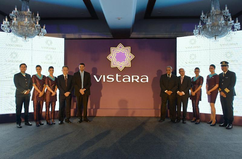 Staff members of TATA SIA Airlines Limited (TSAL) pose during the launch of the new brand name 'Vistara' - Sanskrit word denoting limitless expanse - for the new airline in New Delhi on August 11, 2014 (AFP Photo/Chandan Khanna)