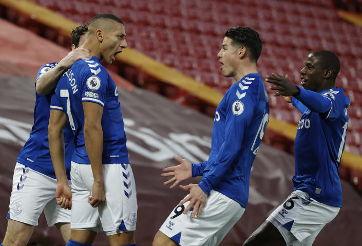 Everton's Richarlison, second left celebrates with teammates after scoring the opening goal of the game during the English Premier League soccer match between Liverpool and Everton at Anfield in Liverpool, England, Saturday, Feb. 20, 2021. (Phil Noble/ Pool via AP)