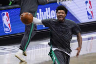 Boston Celtics guard Marcus Smart warms up before the start of an NBA basketball game against the Brooklyn Nets, Friday, April 23, 2021, in New York. (AP Photo/Mary Altaffer)