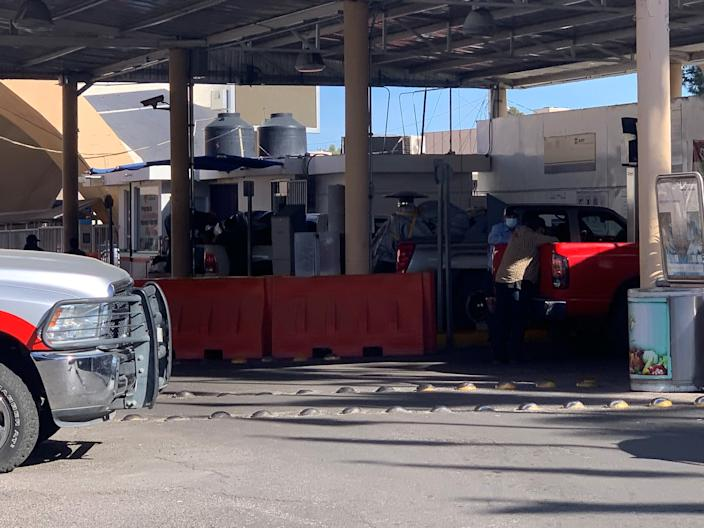 Drivers of trucks and SUV's loaded with bags and boxes wait for Mexican customs officers to finish inspecting their vehicles at the DeConcini port of entry in Nogales, Mexico on Dec. 17, 2020. Thousands of Mexican Americans are expected to travel south to Mexico for the Holidays, despite recommendations to stay home to avoid spreading COVID-19.
