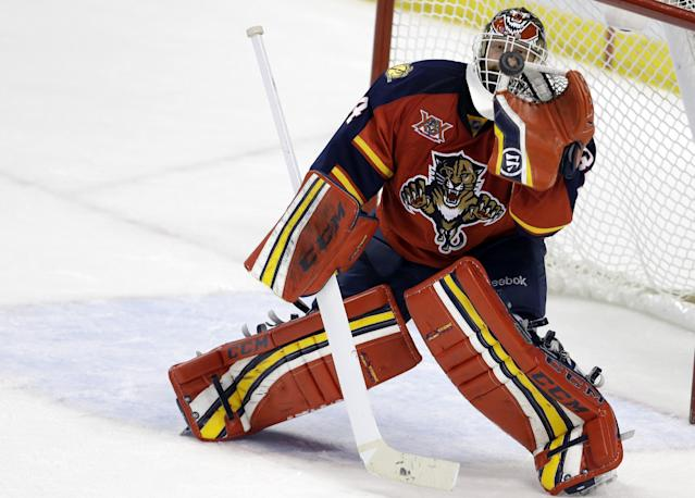 Florida Panthers goalie Tim Thomas stops the puck during the third period of an NHL hockey game against the New York Islanders, Tuesday, Jan. 14, 2014, in Sunrise, Fla. The Panthers defeated the Islanders 4-2. (AP Photo/Lynne Sladky)