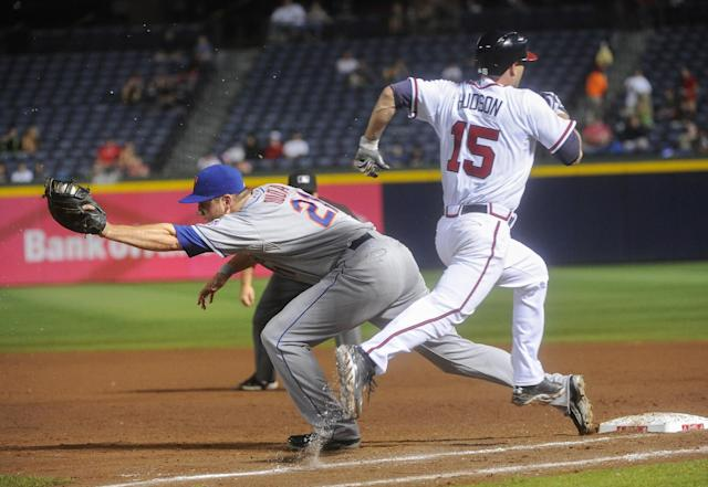 New York Mets first baseman Lucas Duda forces out Atlanta Braves' Tim Hudson (15) on a throw from shortstop Omar Quintanilla during the third inning of a baseball game, Monday, June 17, 2013, in Atlanta. (AP Photo/John Amis)