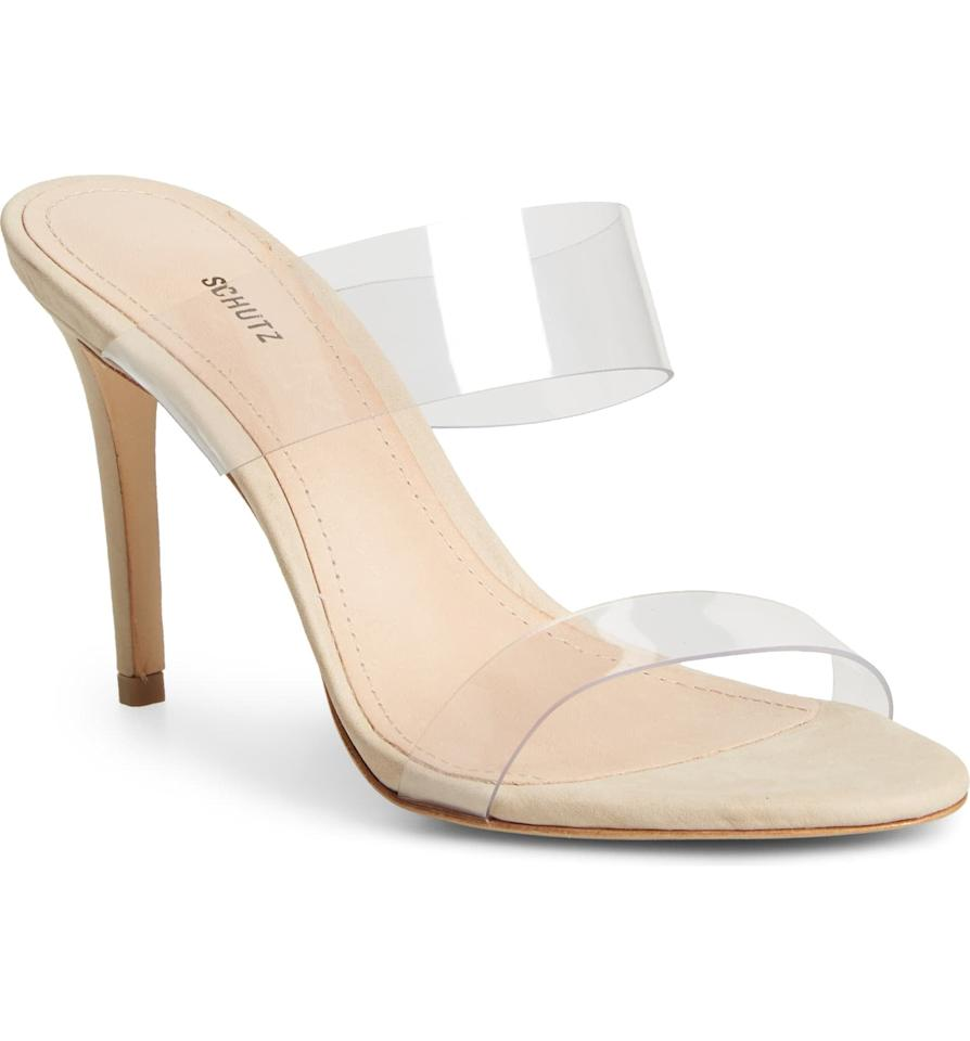 """<p>The <a href=""""https://www.popsugar.com/buy/Schutz-Ariella-Sandal-532709?p_name=Schutz%20Ariella%20Sandal&retailer=shop.nordstrom.com&pid=532709&price=170&evar1=fab%3Aus&evar9=45667172&evar98=https%3A%2F%2Fwww.popsugar.com%2Fphoto-gallery%2F45667172%2Fimage%2F47026275%2FSchutz-Ariella-Sandal&list1=shopping%2Csandals%2Cshoes%2Csummer%2Csummer%20fashion%2Cbest%20of%202020&prop13=api&pdata=1"""" rel=""""nofollow"""" data-shoppable-link=""""1"""" target=""""_blank"""" class=""""ga-track"""" data-ga-category=""""Related"""" data-ga-label=""""https://shop.nordstrom.com/s/schutz-ariella-sandal-women/5528189/full?origin=category-personalizedsort&amp;breadcrumb=Home%2FWomen%2FShoes%2FSandals&amp;color=beige%2Ftransparent%20vinyl%20fabric"""" data-ga-action=""""In-Line Links"""">Schutz Ariella Sandal</a> ($170) is going to be one of your most worn shoes. Trust us on this one. They go with every single outfit you could ever imagine, and they're actually comfortable.</p>"""
