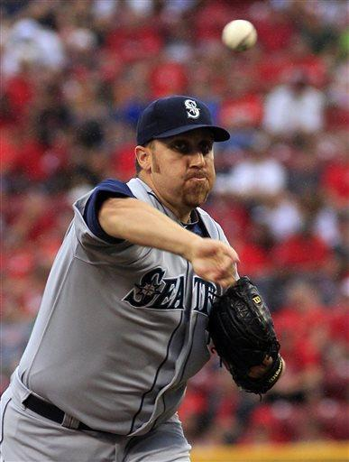 Seattle Mariners' Aaron Harang pitches against Cincinnati Reds in the first inning of their baseball game in Cincinnati, Friday July 5, 2013. (AP Photo/Tom Uhlman)