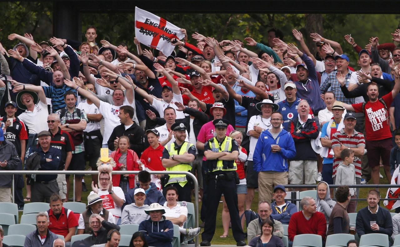 """England supporters from the """"Barmy Army"""" fan organisation cheer during the fifth day's play in the second Ashes cricket test between England and Australia at the Adelaide Oval December 9, 2013. REUTERS/David Gray (AUSTRALIA - Tags: SPORT CRICKET)"""