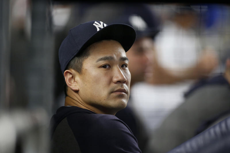 NEW YORK, NEW YORK - AUGUST 02: Masahiro Tanaka #19 of the New York Yankees looks on from the dugout during the fifth inning against the Boston Red Sox at Yankee Stadium on August 02, 2019 in New York City. (Photo by Jim McIsaac/Getty Images)