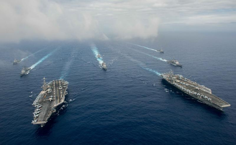 In this handout provided by the U.S. Navy, The Nimitz-class aircraft carriers USS John C. Stennis (CVN 74) (L) and USS Ronald Reagan (CVN 76) conduct dual aircraft carrier strike group operations in the U.S. 7th Fleet area of operations in support of security and stability in the Indo-Asia-Pacific. (Photo by Specialist 3rd Class Jake Greenberg/U.S. Navy via Getty Images)