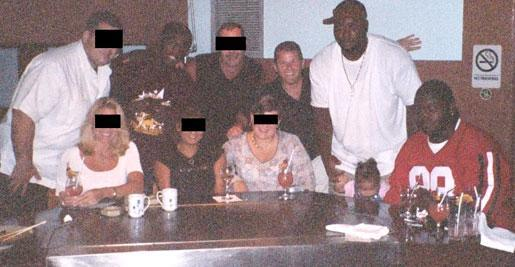 Nevin Shapiro and a second source say this photo was taken at Japanese steakhouse Benihana in 2003. The dinner, which was paid for by Shapiro, was attended by players Jonathan Vilma (standing on left), Santonio Thomas (standing on right) and Vince Wilfork (seated in red on right).