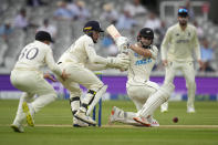 New Zealand's Henry Nicholls plays a shot off the bowling of England's Joe Root during the first day of the Test match between England and New Zealand at Lord's cricket ground in London, Wednesday, June 2, 2021. (AP Photo/Kirsty Wigglesworth)