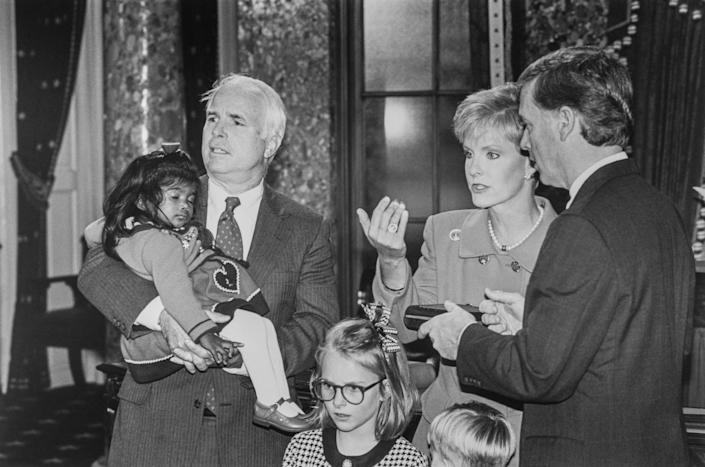 McCain, holding recently adopted Bridget, with wife Cindy Hensley, Vice President Dan Quayle and daughter Meghan during Mock Swearing on Jan. 7, 1993.