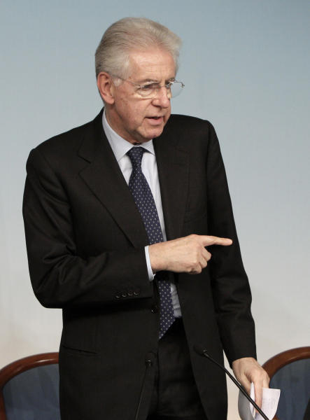 FILE - In this Dec. 6, 2012 file photo, Italian Premier Mario Monti gestures during a news conference at the end of a cabinet meeting, at the Chigi Palace government office, Rome. Premier Mario Monti told the Italian president Saturday, Dec. 8, 2012, he plans to resign following the sudden loss of support from Silvio Berlusconi's party, paving the way for early elections a year after the economist helped pull the country back from the brink of financial disaster. (AP Photo/Riccardo De Luca, File)