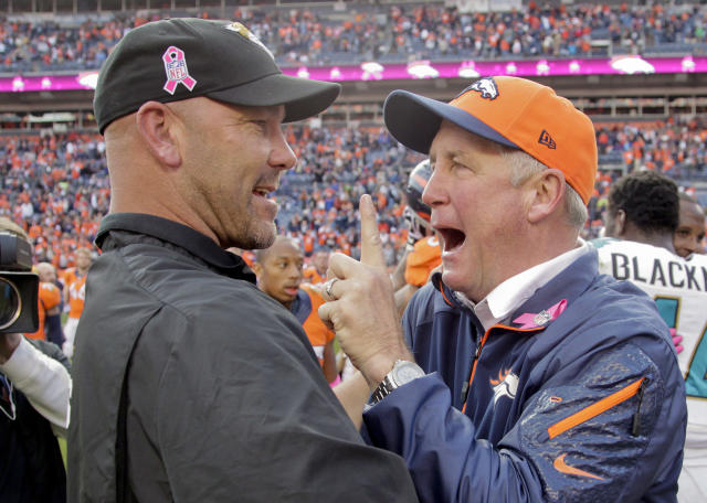 Denver Broncos coach John Fox, right, greets Jacksonville Jaguars coach Gus Bradley at mid field after the Broncos beat the Jaguars 35-19 in an NFL football game, Sunday, Oct. 13, 2013, in Denver. (AP Photo/Joe Mahoney)