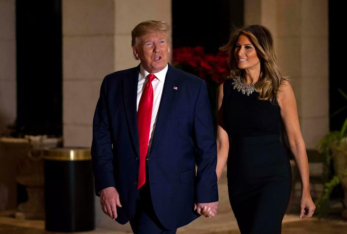President Donald Trump and first lady Melania arrive for Christmas dinner at the ballroom at Mar-a-Lago in Palm Beach, Dec. 24, 2019. [ALLEN EYESTONE/palmbeachpost.com]
