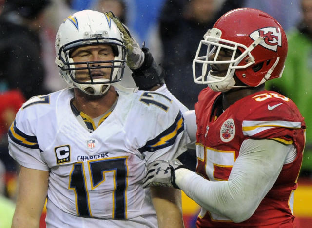 Kansas City Chiefs linebacker Dee Ford (55) pats San Diego Chargers quarterback Philip Rivers (17) on the helmet. (AP Photo/Ed Zurga)