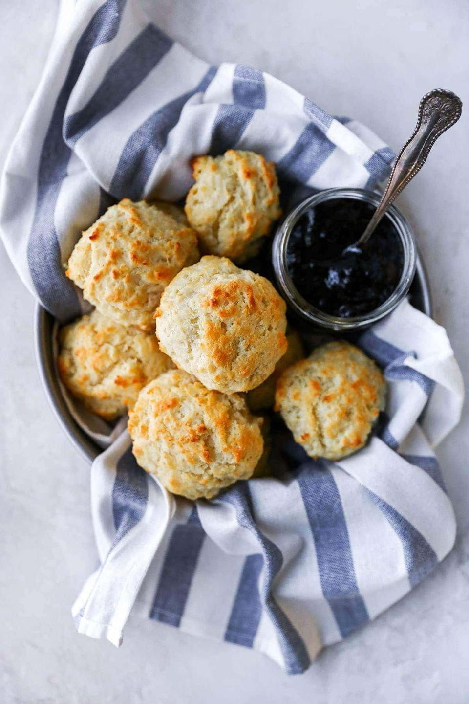 """<p>Though biscuits have decidedly Southern roots, no cookout should be complete without this decadent, go-with-anything side. </p><p><a href=""""https://www.twopeasandtheirpod.com/recipe-for-buttermilk-drop-biscuits/"""" rel=""""nofollow noopener"""" target=""""_blank"""" data-ylk=""""slk:Get the recipe."""" class=""""link rapid-noclick-resp"""">Get the recipe. </a></p>"""