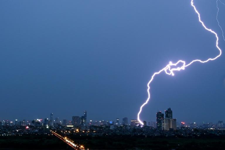 The UN weather agency measures lightning using satellite imagery technology (AFP Photo/Manan VATSYAYANA)