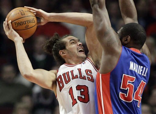 Chicago Bulls center Joakim Noah (13) goes up for a shot against Detroit Pistons forward Jason Maxiell (54) during the first half of an NBA basketball game in Chicago, Friday, March 30, 2012. (AP Photo/Nam Y. Huh)