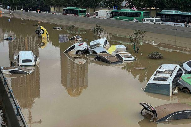 PHOTO: Cars sit in floodwaters after heavy rains in China, July 21, 2021. (AFP via Getty Images)