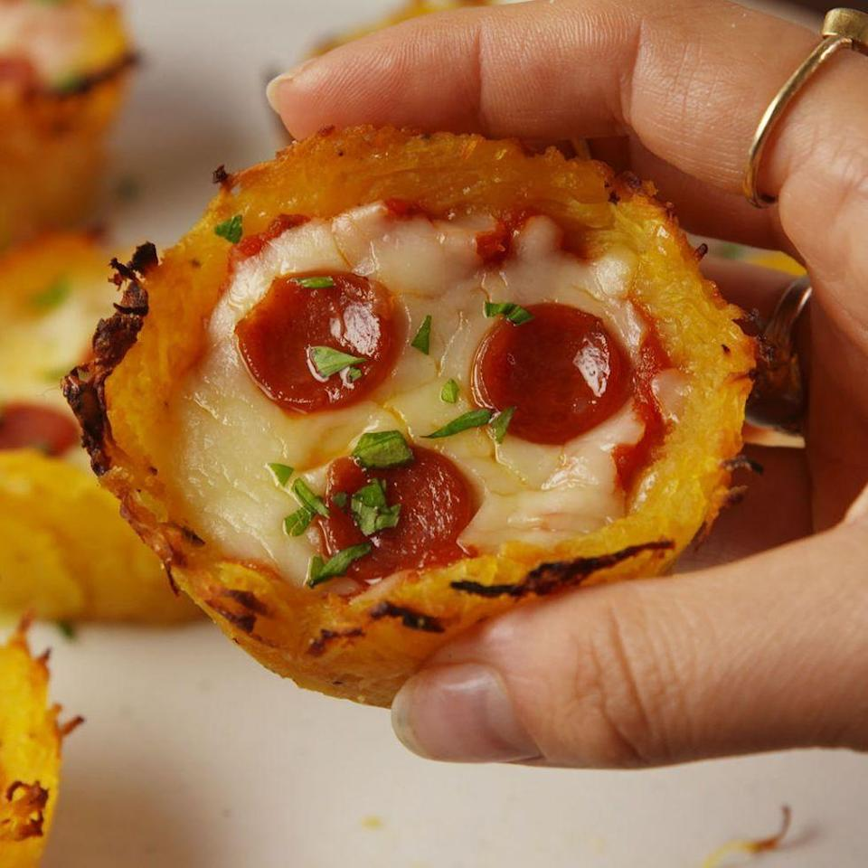 "<p>A low carb pizza bite! </p><p>Get the <a href=""https://www.delish.com/uk/cooking/recipes/a34973015/spaghetti-squash-pizza-nests-recipe/"" rel=""nofollow noopener"" target=""_blank"" data-ylk=""slk:Spaghetti Squash Pizza Nests"" class=""link rapid-noclick-resp"">Spaghetti Squash Pizza Nests</a> recipe.</p>"