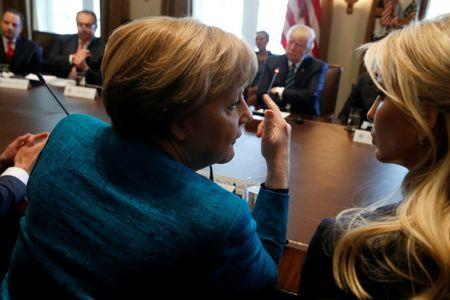 Merkel and Ivanka Trump speak during a roundtable discussion between Trump and German and U.S. business leaders on vocational training at the White House in Washington