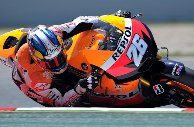Repsol Honda Team's Spanish Dani Pedrosa takes a curve at the Catalunya racetrack in Montmelo, near Barcelona, on June 1, 2012, during the MotoGP second training session of the Catalunya Moto GP Grand Prix. AFP PHOTO/LLUIS GENE.LLUIS GENE/AFP/GettyImages