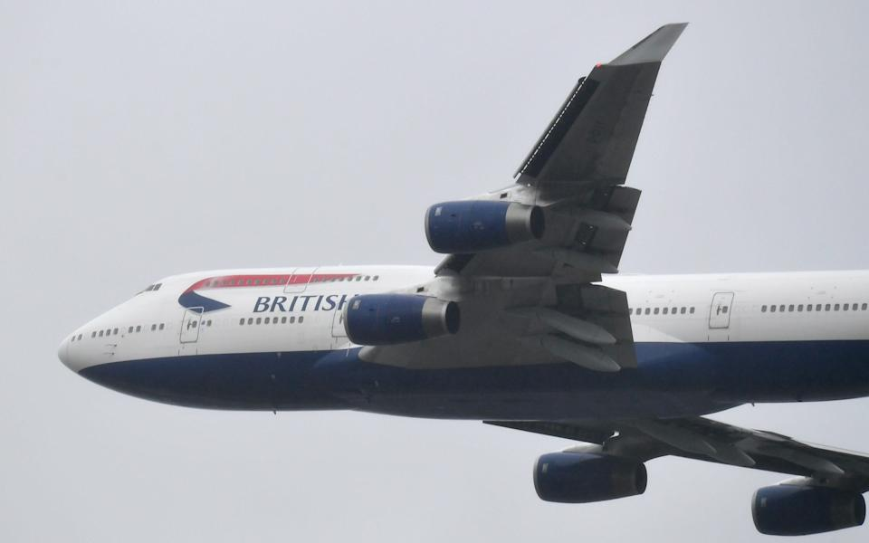 A British Airways Boeing 747 does a flypast over London Heathrow airport on it's final flight, the last of 31 jumbo jets to be retired early by the airline due to pandemic - Toby Melville /  REUTERS