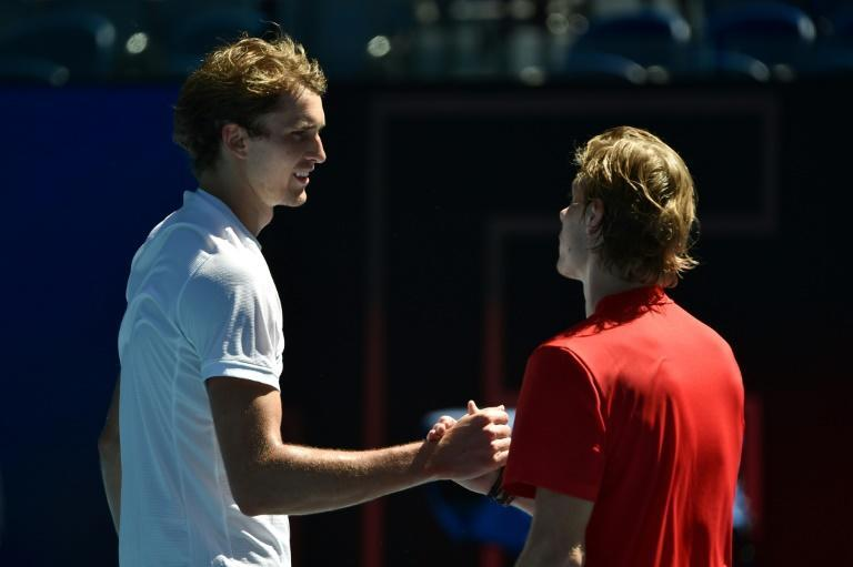 Alexander Zverev (left) battled past Denis Shapovalov in three tough sets