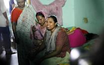 The wife (R) of murdered Bangladeshi blogger Niloy Chakrabarti, who used the pen-name Niloy Neel, weeps at their home in Dhaka on August 7, 2015 (AFP Photo/)