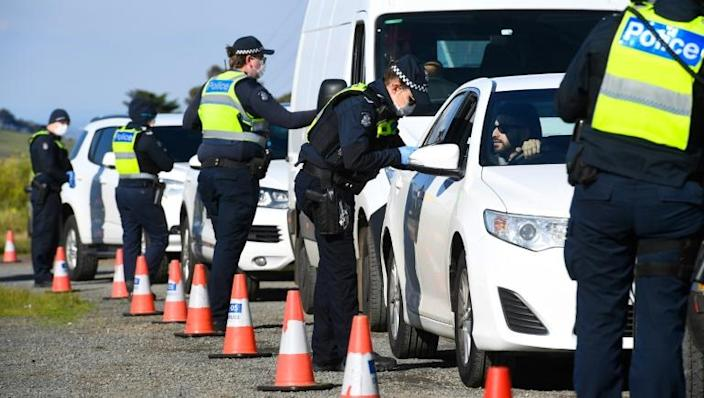 A rush of travellers across the border from Victoria into neighbouring New South Wales has raised concerns that efforts to contain the virus could be torpedoed (AFP Photo/William WEST)